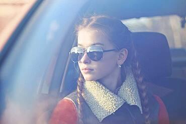 Caucasian teenage girl sitting in car