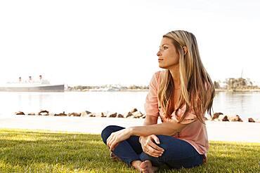 Caucasian woman sitting in park