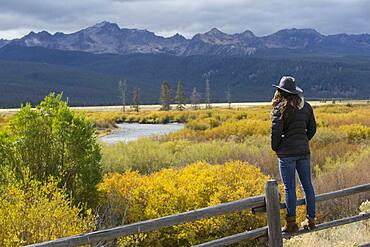 Caucasian woman admiring Sawtooth Range, Stanley, Idaho, United States