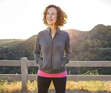 Caucasian woman smiling on hilltop