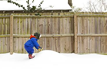 Caucasian boy playing in snow