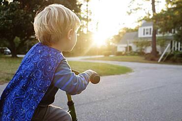 Caucasian boy riding bicycle