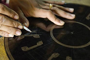 Asian artisan carving traditional design