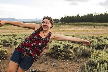 Caucasian woman posing in remote field