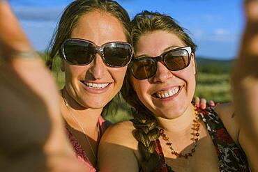 Caucasian women in sunglasses taking selfie