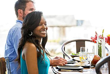 Couple smiling at dining room table