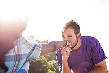 Man kissing hand of girlfriend