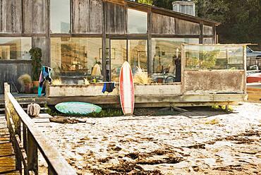 Surfboards in backyard of beach house