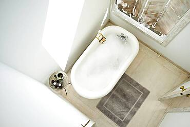 High angle view of bubble bath in bathroom