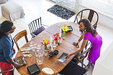 Couple setting dining room table