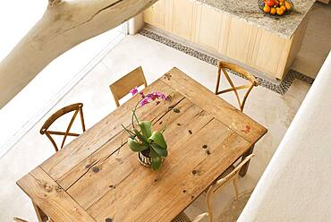 High angle view of dining table and chairs in kitchen