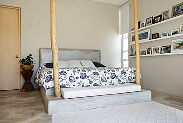 Bed and bedposts in modern bedroom