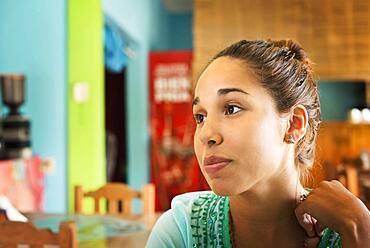 Hispanic woman sitting in cafe