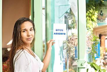 Hispanic business owner opening shop