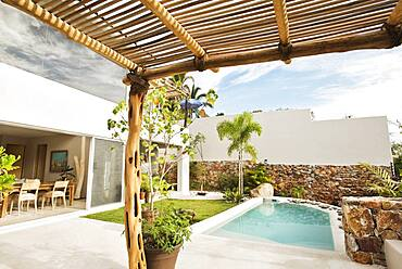 Swimming pool and canopy in backyard