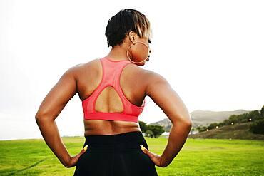 Black woman standing in field