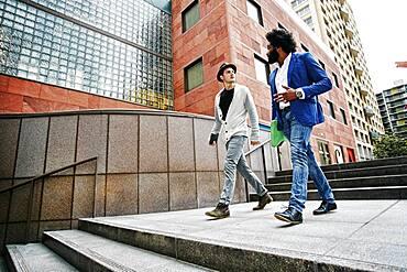 Businessmen talking on steps