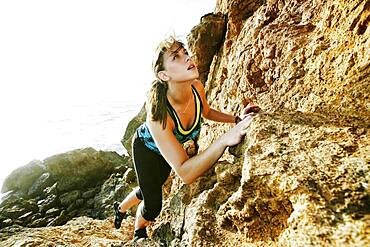 Woman climbing on boulders