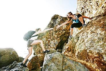 Women climbing on boulders