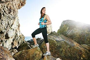 Woman hiking on boulders