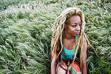 Black woman sitting in grass