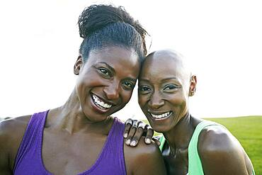 Women smiling in park