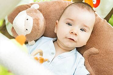 Mixed race baby laying on pillow