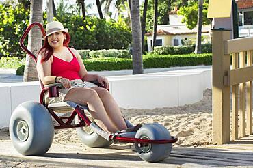 Paraplegic woman in wheelchair in park