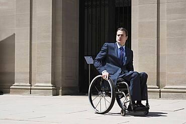 Paraplegic businessman sitting in wheelchair