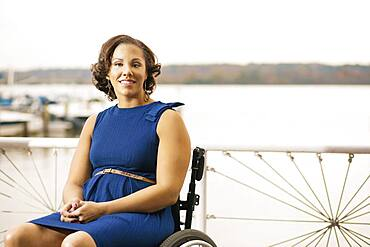 Disabled woman smiling in wheelchair