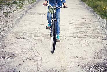 Caucasian teenage girl riding bicycle