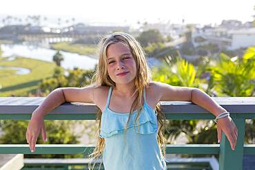 Caucasian girl standing on balcony