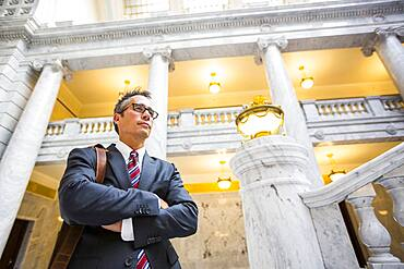 Mixed race businessman standing in courthouse