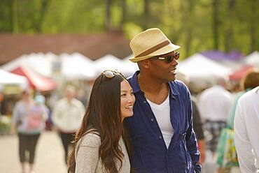 Couple shopping at farmers market