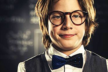 Close up of student wearing bow tie and eyeglasses