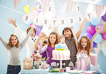 Children cheering at birthday party