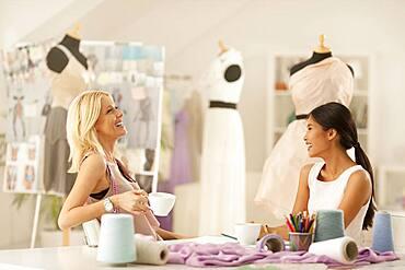 Fashion designers talking in studio