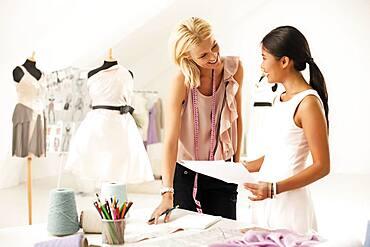 Fashion designers working together in studio