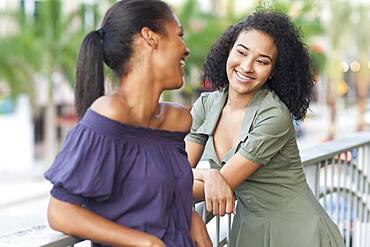 Black woman talking on balcony outdoors