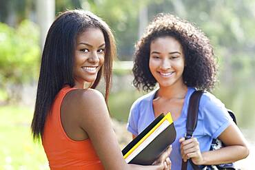 Black students smiling outdoors