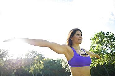 Caucasian athlete practicing yoga in park