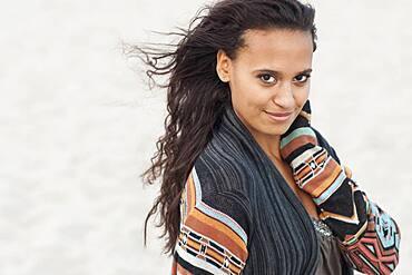 Mixed race woman wearing stylish sweater