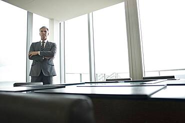 Caucasian businessman standing in empty conference room