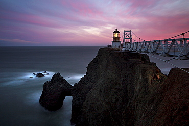 Lighthouse on rocky cliffs over ocean coastline, Sausalito, California, United States