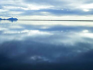 Reflection of clouds in still water