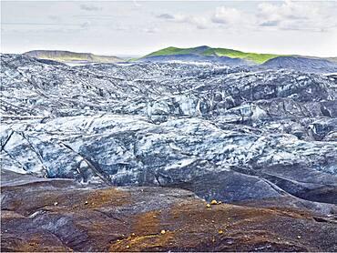 Snow on remote rock formations, Myrdalsjokull Glacier, South Iceland, Iceland