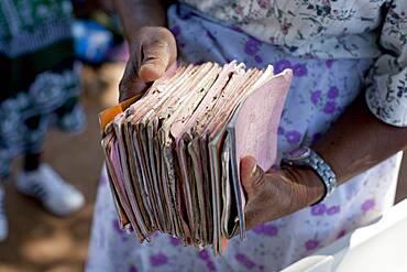 Close up of hands holding dilapidated treatment records