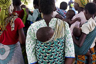 Mothers carrying children and waiting at rural health clinic