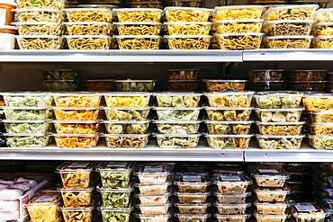 Packaged deli foods on store shelves