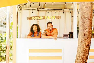 Couple leaning in beach shack